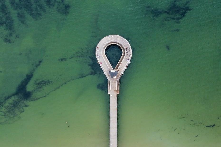 drone shot of dock in the ocean