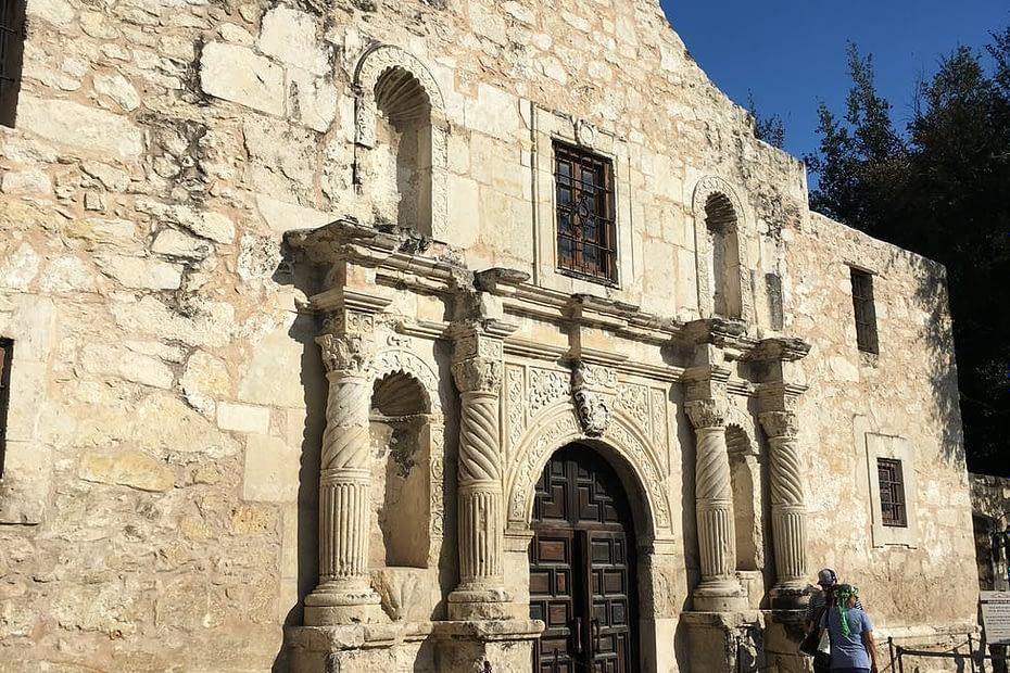 facade of ancient roman catholic church on sunny day